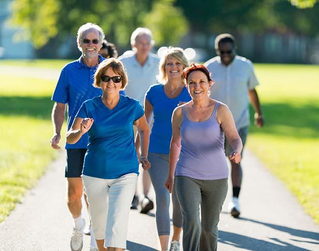 senior citizens walking outside